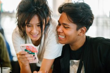teen boy and girl looking at phone